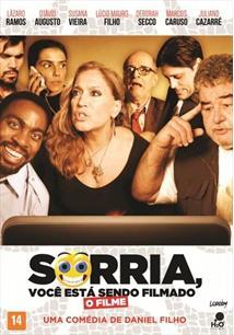 SORRIA, VOCÊ ESTÁ SENDO FILMADO
